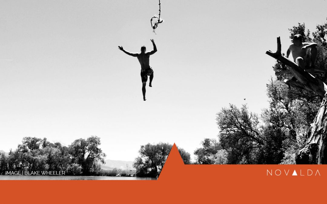 Figure leaping into water represents leading from the growth mindset