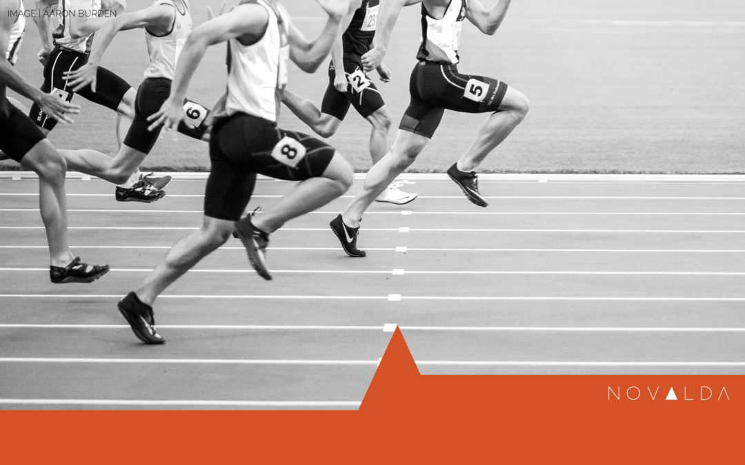 Image of racers at the starting line illustrates competition and collaboration in leading change.