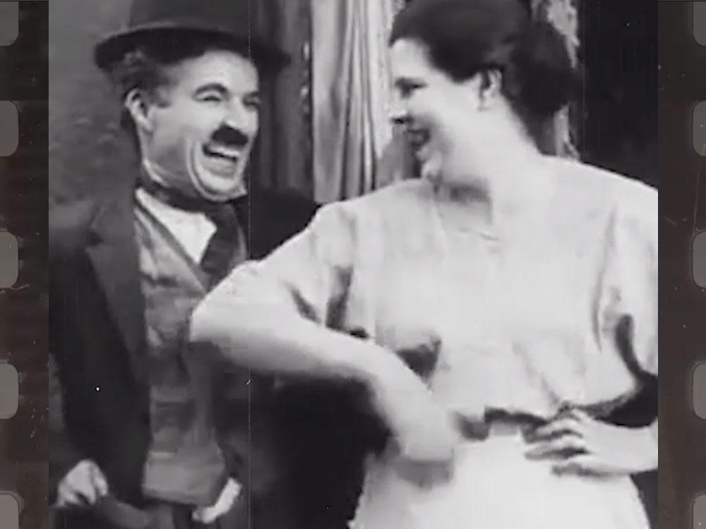 Image of Chaplin kidding with woman represents Novalda's team coach mentoring program.