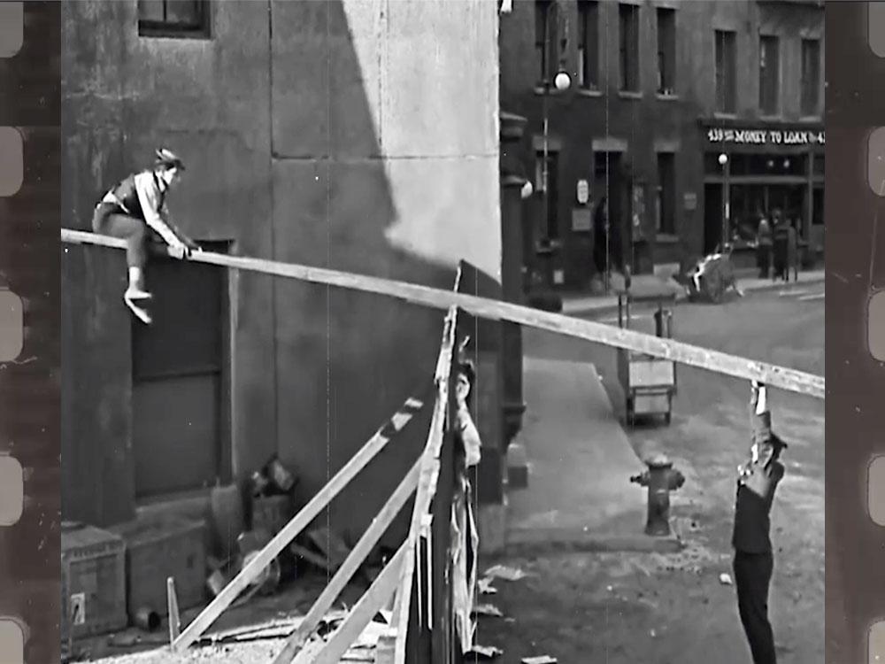 Image of Buster Keaton using ladder as springboard represents change leadership development