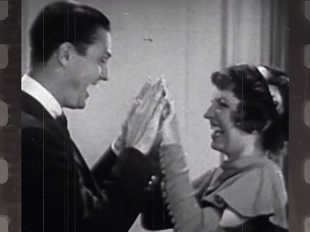 Vintage image of couple playing pattycake represents collaborative team services.