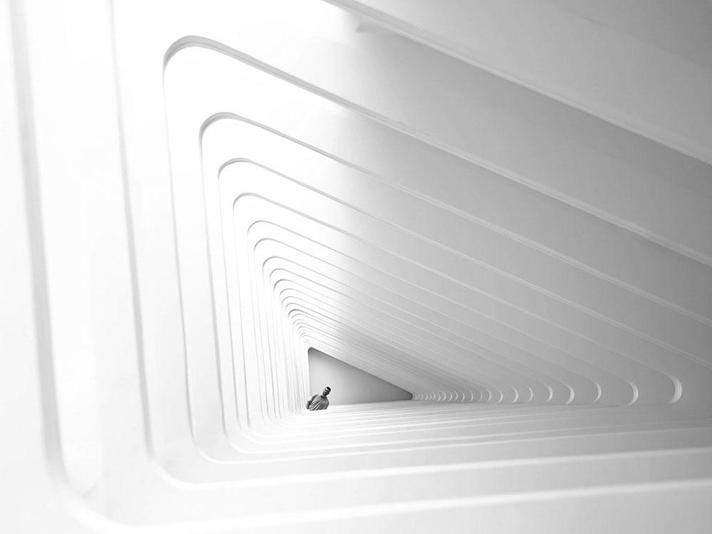 Spiraling triangular staircase represents change leadership development