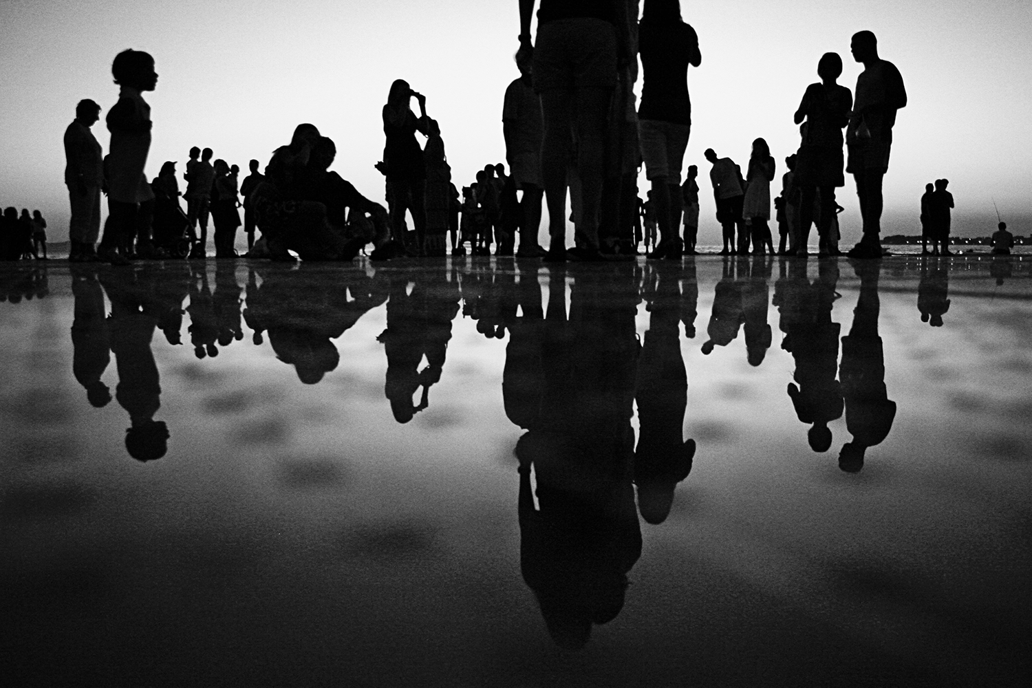 black and white image silhouettes of group systems coaching