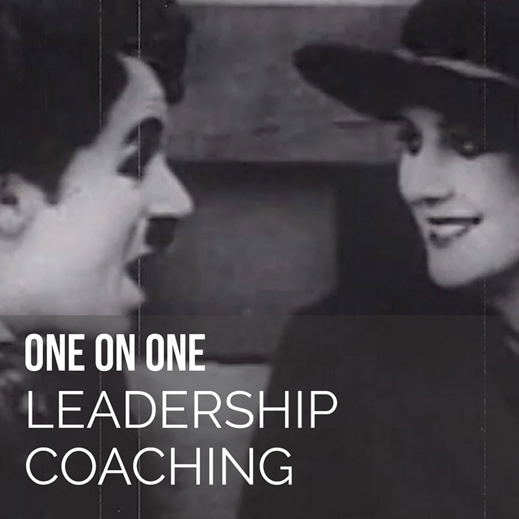 Delighted Chaplin looking at girl one-on-one leadership coaching Novalda.